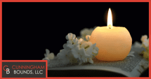 a candle against a dark background